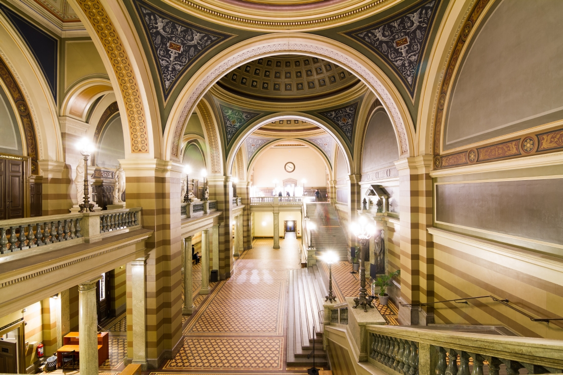 Grand interieur hall with marble floor, arches and cupola ceilings. Photo.